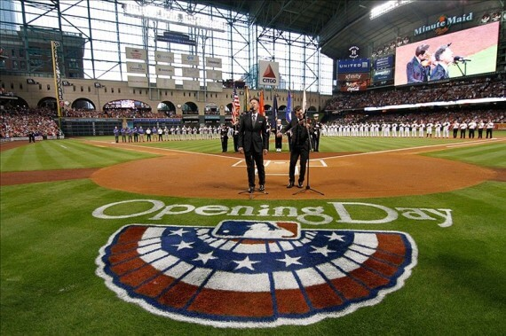 Musician Lyle Lovett sings the national anthem before a game between the Houston Astros and Texas Rangers on Opening Day at Minute Maid Park. (Brett Davis-USA TODAY Sports)
